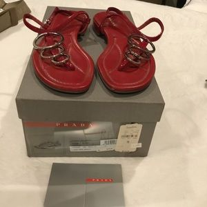 Red Prada sandals